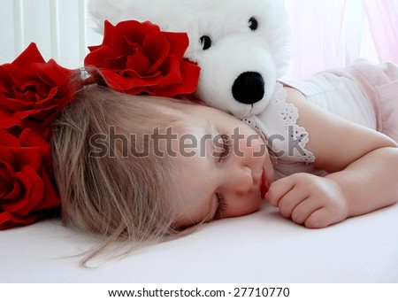 little girl sleeping and hugging her teddy bear - stock photo