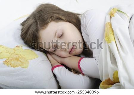 little girl sleeping in her bed - stock photo