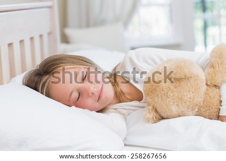 Little girl sleeping in her bed at home in the bedroom - stock photo