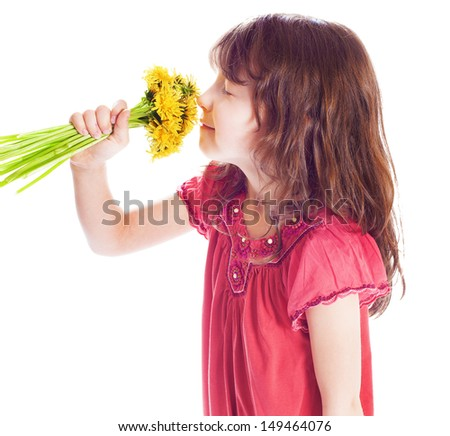 little girl smelling a flower. isolated on white background - stock photo