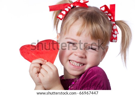 Little girl smile with drawn heart