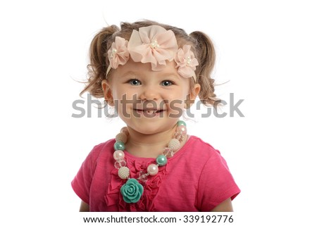 Little girl smiling isolated o a white background - stock photo