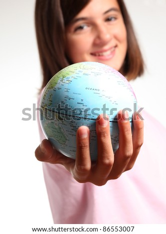 Little girl smiling little holding and offering a planet earth, symbol of environmental conservation, isolated on white background
