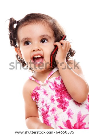 Little girl speaking by cell phone, white background - stock photo