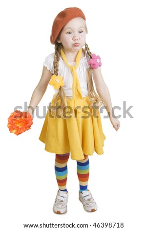Little girl standing and holding a flower.