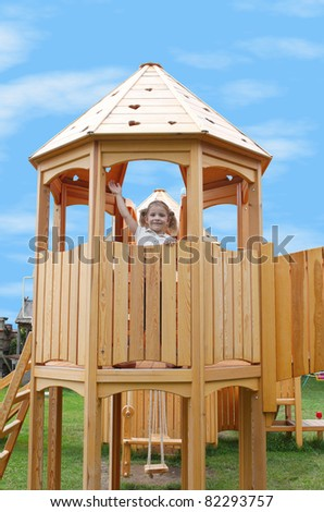 little girl standing in playground tower - stock photo