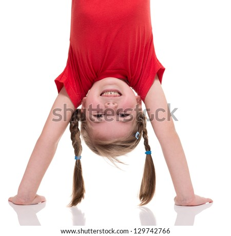 little girl standing on her hand isolated on white - stock photo
