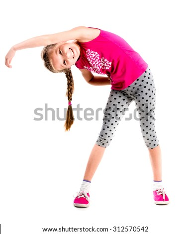 little girl standing with hands on sides doing fitness - stock photo