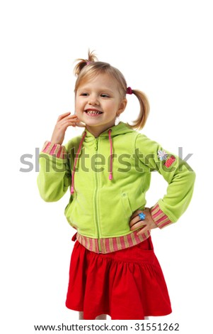 little girl stands near a wall, red skirt, green woman's jacket, white background,  pigtails - stock photo