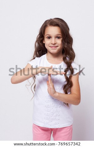 Little girl. Stop gesture. White background.