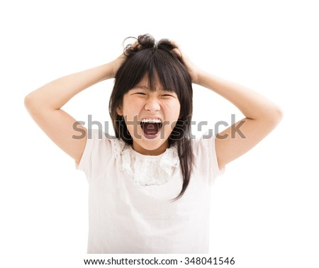 little girl struggling and her hands in  hair - stock photo
