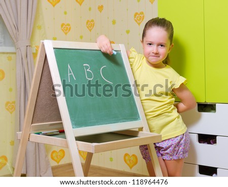 Little girl studies at home - stock photo