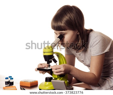 little girl  study with microscope isolated on white background - stock photo