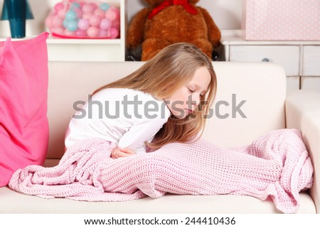 Little girl suffering from stomach-ache - stock photo