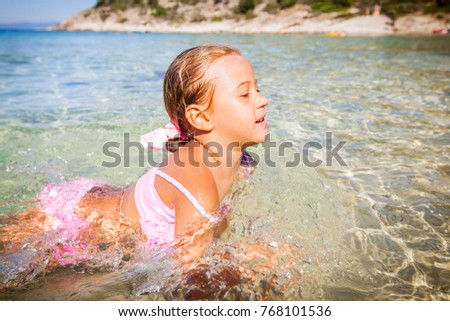 Little girl swimming in the sea. Summer travel Vacation