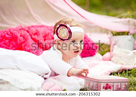 Little girl takes a box  - stock photo