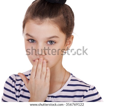 Little girl teenager closes her mouth, isolated on white - stock photo