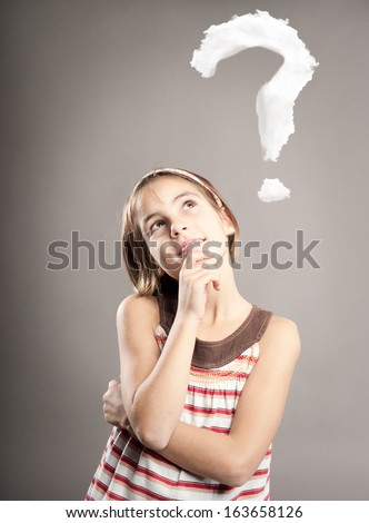 little girl thinking with n interrogation symbol over her head - stock photo