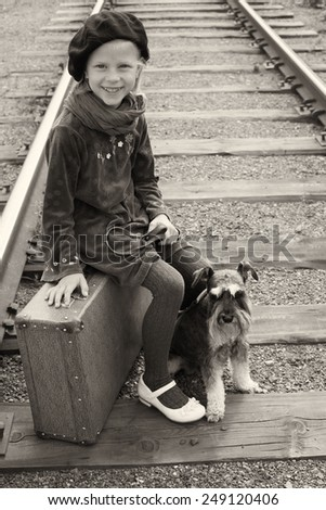 Little girl traveling with her dog. The old European photo. - stock photo