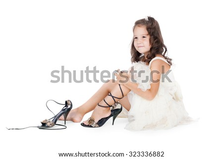 little girl trying on the big shoes