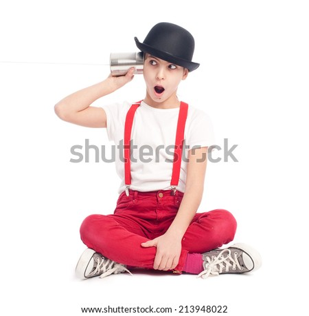 little girl using a can as telephone on a white background - stock photo
