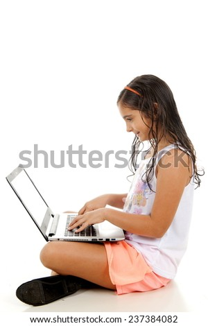 Little Girl using a laptop . - stock photo