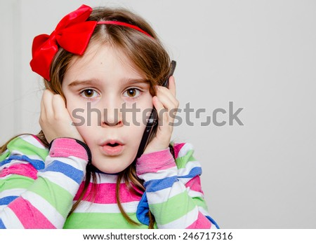 Little girl using phone - stock photo