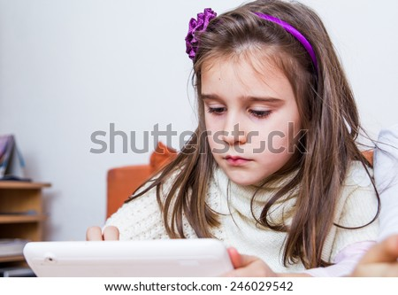 Little girl using tablet - stock photo