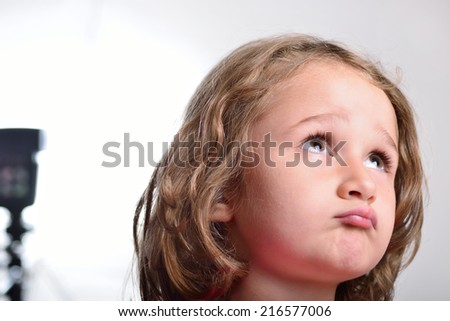 Little girl visiting and having fun in a photo studio