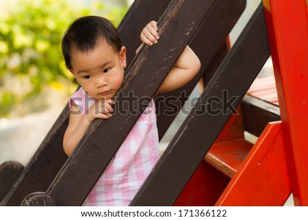 little girl waiting for mom at playground