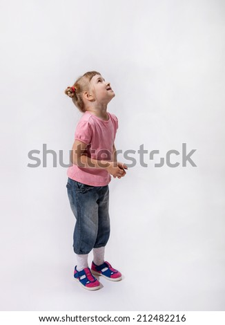 Little girl waiting something and looking up, white background - stock photo