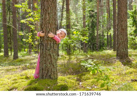 Little girl walking in the forest - stock photo