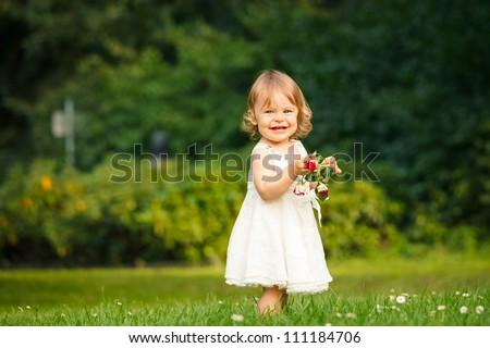 Little girl walking in the park - stock photo