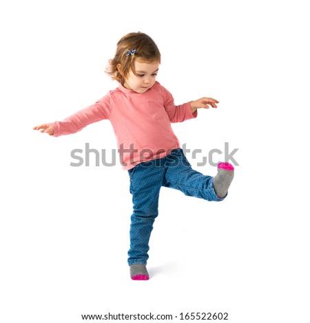 Little girl walking over white background - stock photo