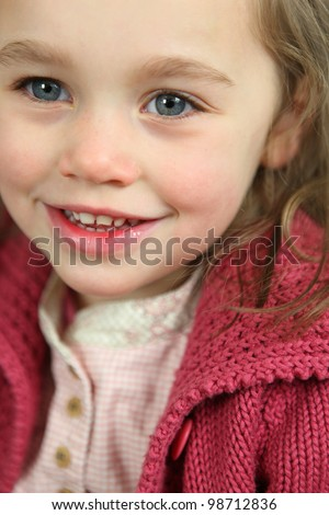 Little girl wearing pink cardigan - stock photo