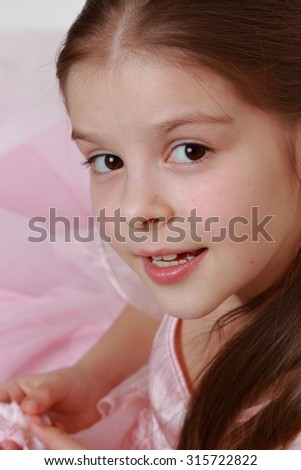 Little girl wearing pink dress as a princess