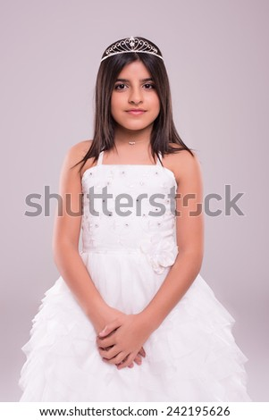 Little girl wearing princess fantasy over soft pink background - stock photo