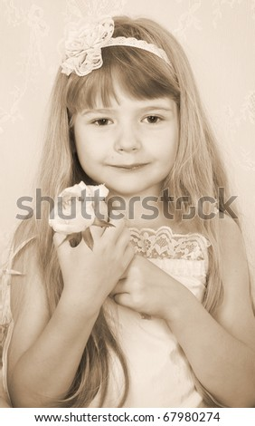 little girl wearing vintage clothes with rose toned sepia image - stock photo