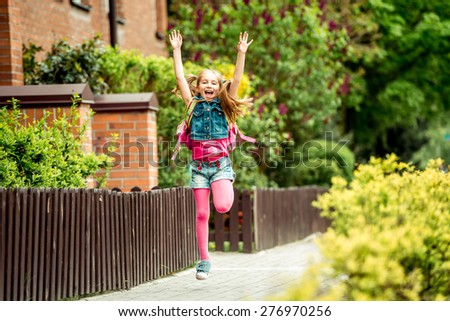little girl with a backpack going to school. - stock photo