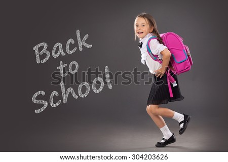 Little girl with a backpack going to school. Place for text, education background. School, fashion concept - stock photo