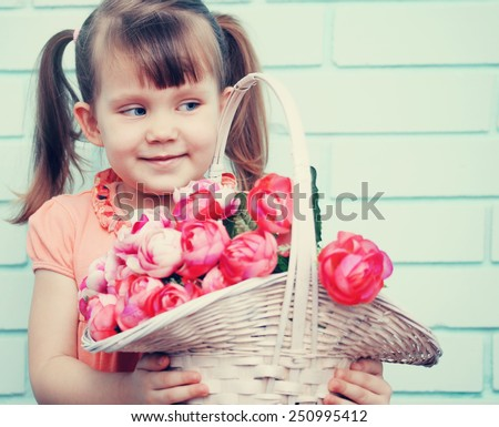 Little girl with a basket of pink roses - stock photo