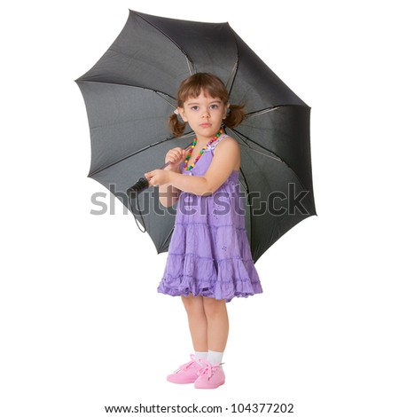 Little girl with a big black umbrella isolated on white background