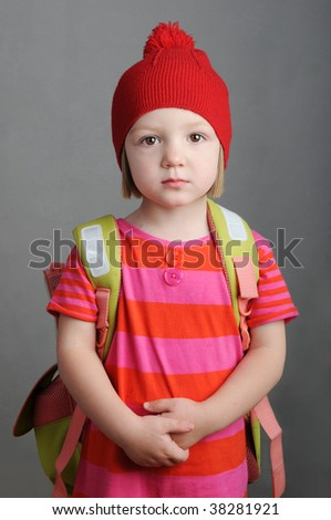 little girl with a big school backpack - stock photo
