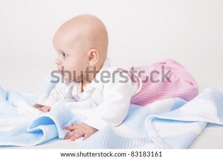 little girl with a blue towel. baby. Studio photography
