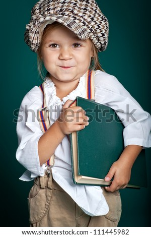 Little girl with a book - stock photo