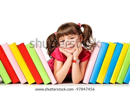little girl with a books on the floor looking up. Isolated on white background - stock photo