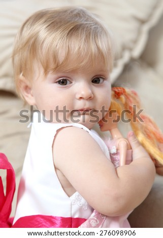 little girl with a doll - stock photo