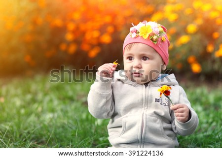 little girl with a flower in her hand
