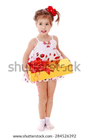 Little girl with a gift- isolated on white background - stock photo