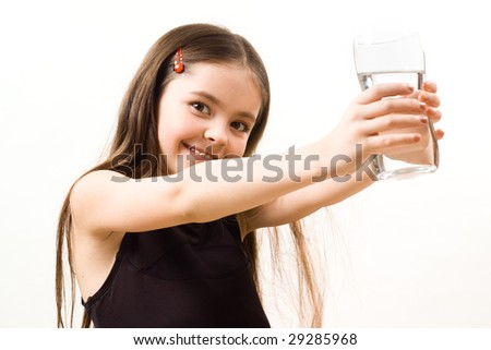 Little girl with a glass - stock photo